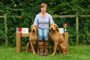 Charlie, Hercules and proud mum Jenny amidst the days winnings.